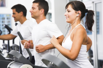 Running on exercise machines at the fitness club