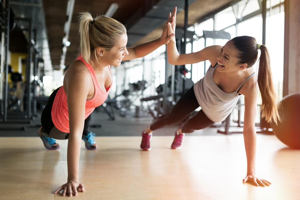 Two young females enjoying working out. How Your Body Adapts to the Stress of Exercise & the Importance of not overtraining