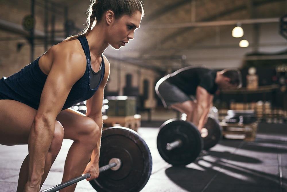 A woman and a man doing deadlift strength-training exercises