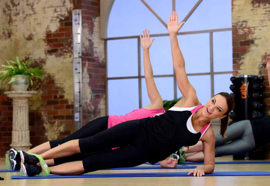 image of doing a plank to strengthen her core in Fit Split Boxing & Boot Camp