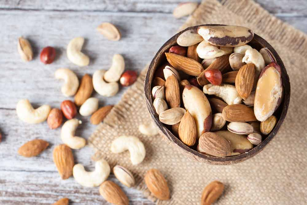 image of healthy nuts in a bowl and on a table