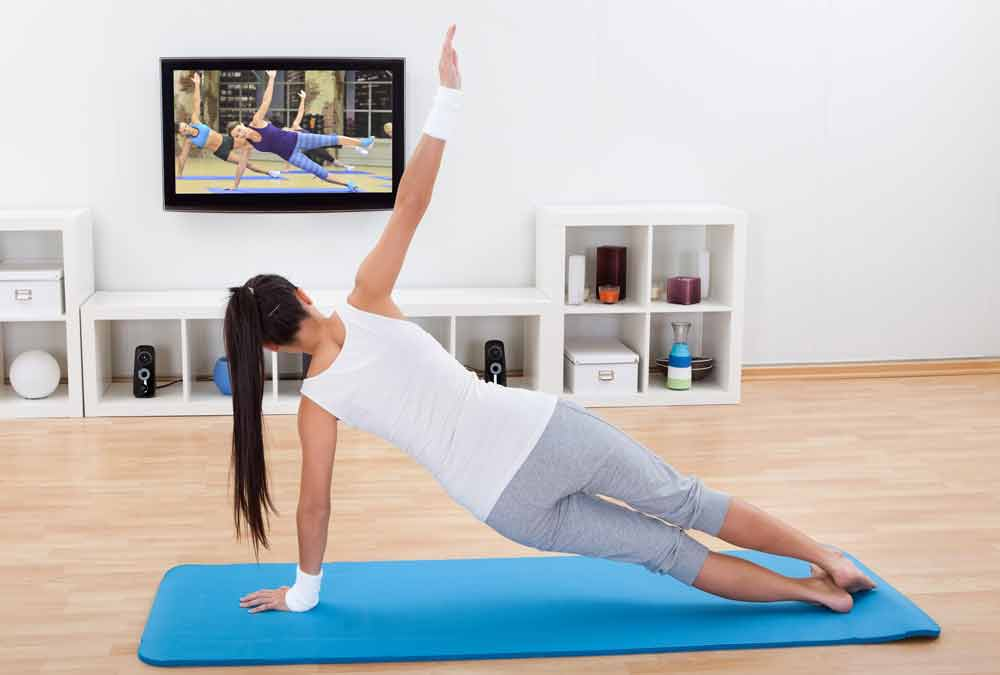 image of female exerciser exercising  to Cathe On Demand online streaming service