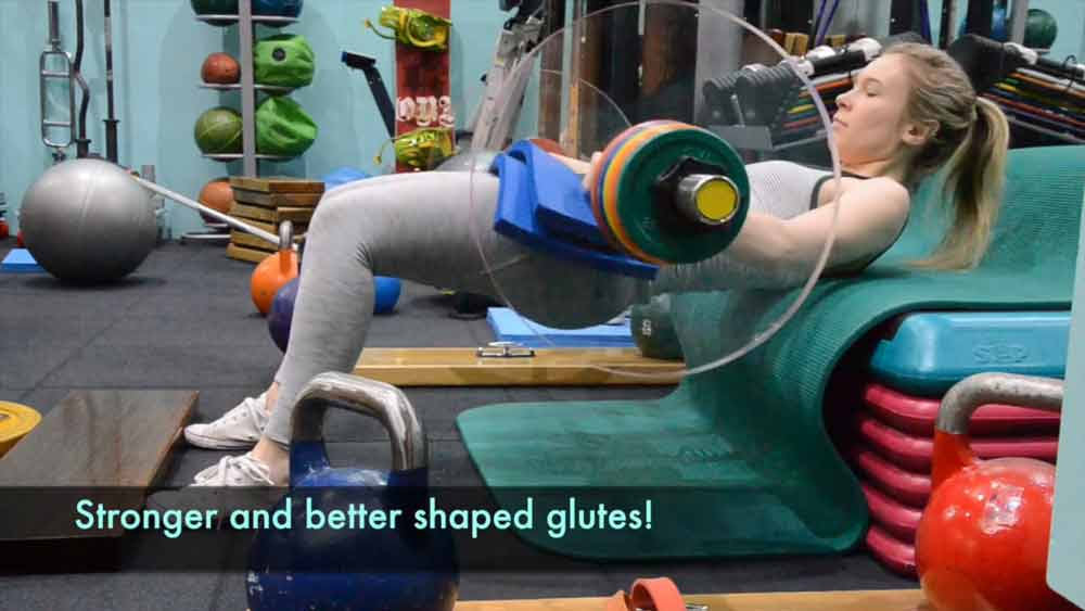 image of a female exerciser doing a barbell hip thrust for her glutes