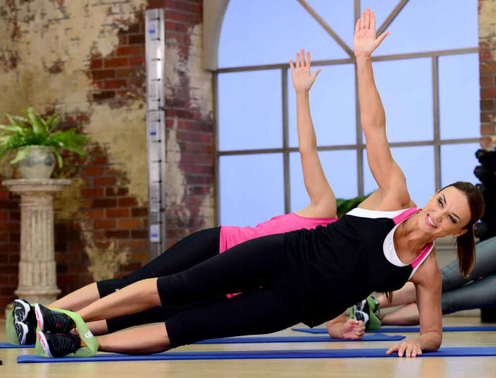 image of Cathe during Fit Split Bonus Abs doing a Plank. Do you know how long you should hold a plank?