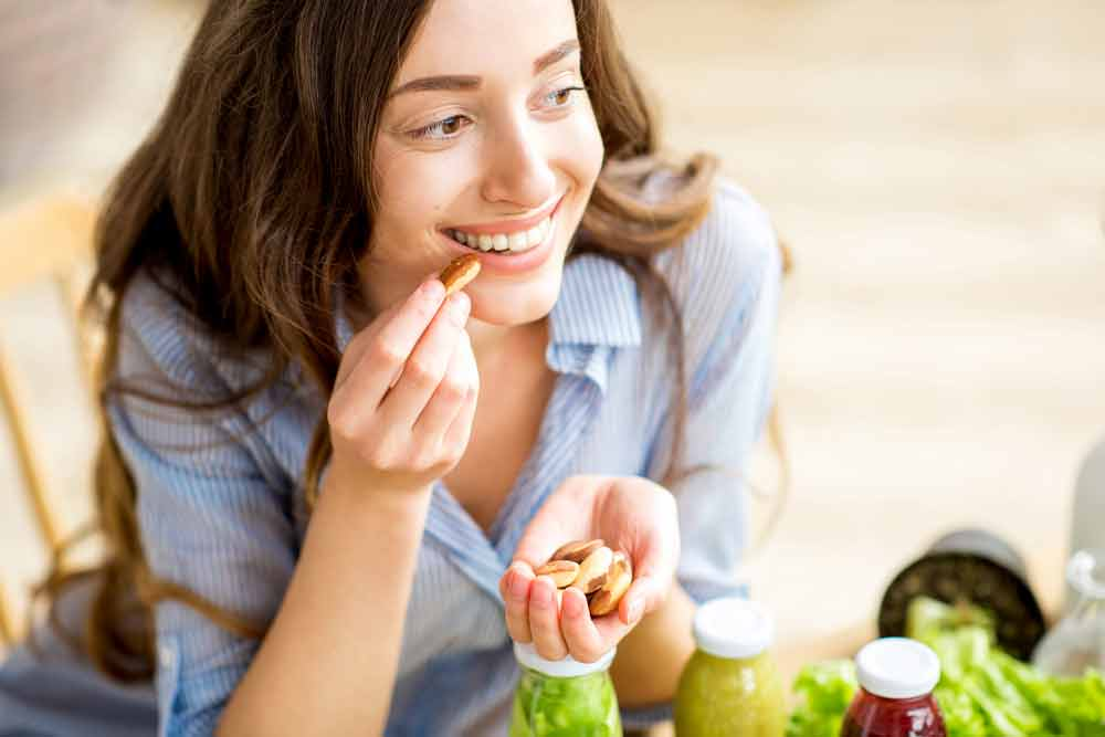 image of a woman eating nuts