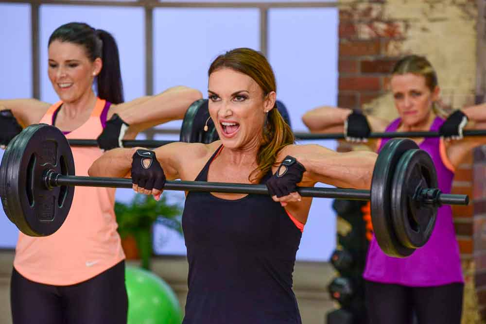 image of Cathe,Jenn and Brenda doing a barbell upright row in Fit Split Pull Day. Does exercise order impact your strength gains?