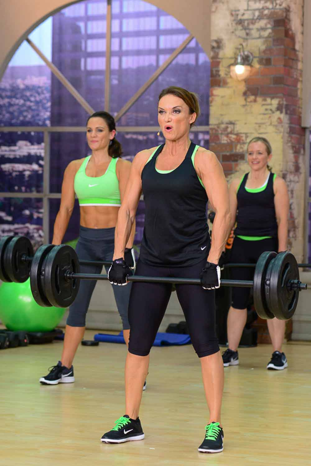 image of Cathe, Amanda and Brenda weight training doing a deadlift in Strong & Sweat Total Body Giant Sets