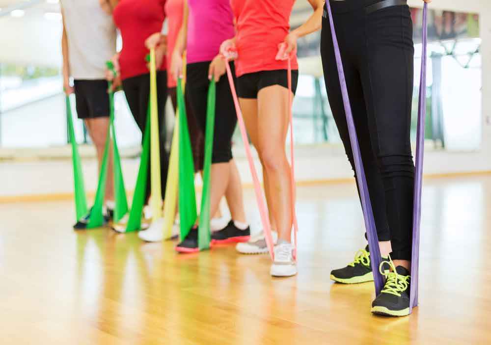 image of exercisers using resistance bands