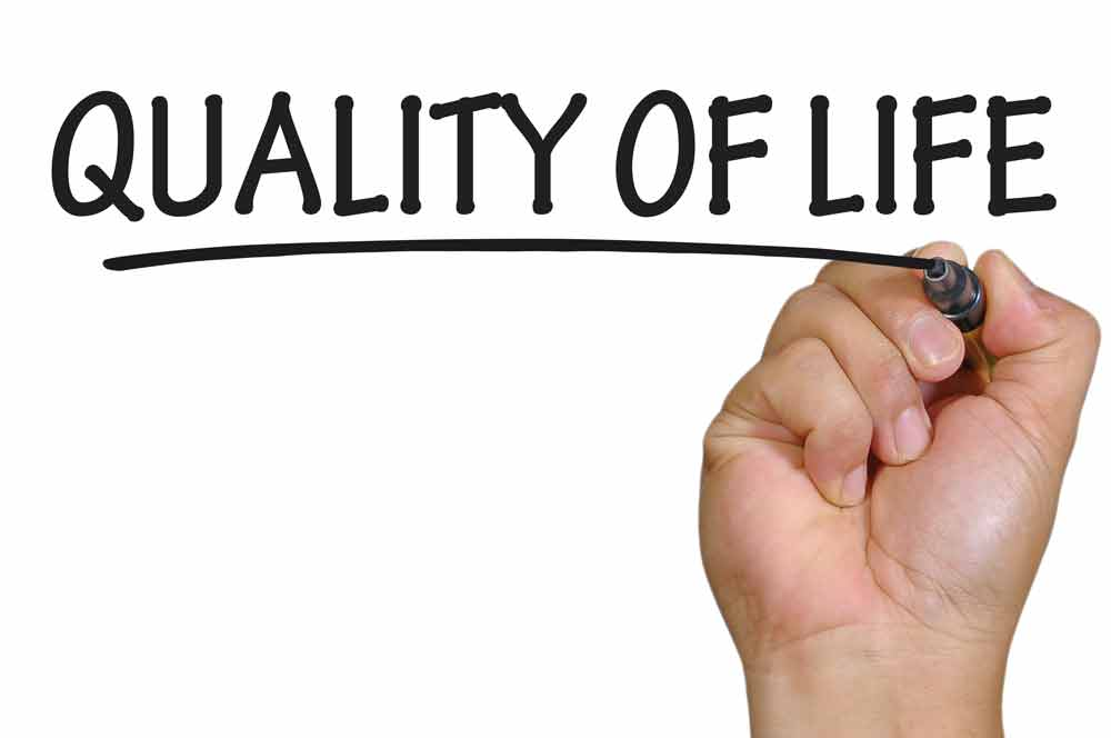 image of a hand writing the words Quality of Life to promote improving health span