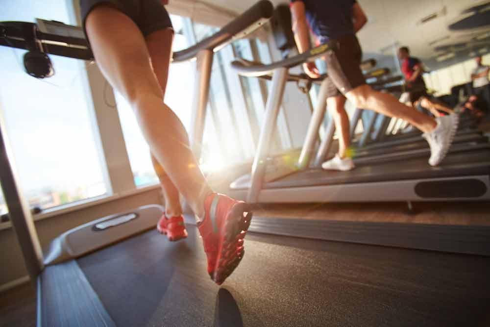 image of female running on treadmill