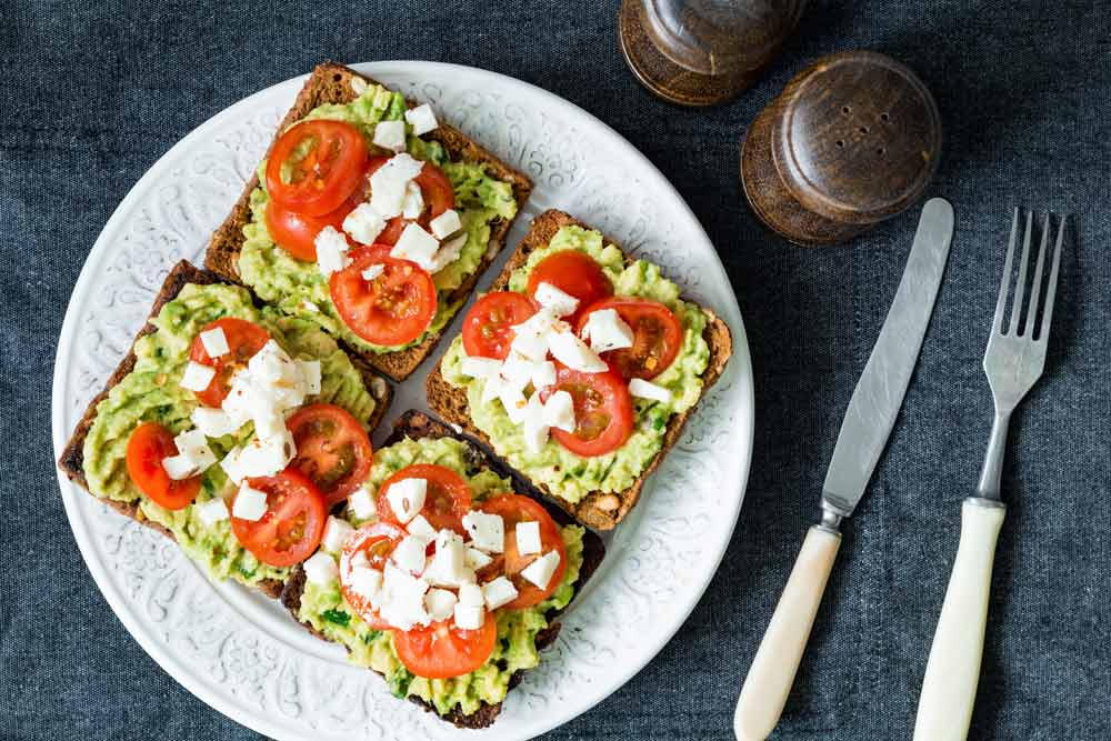 image of four avacado toast sandwiches as another way to enjoy breakfast vegetables in the morning