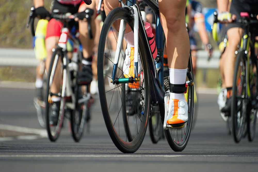 image of an outdoor cycle race, Does cycling help or hurt bone health