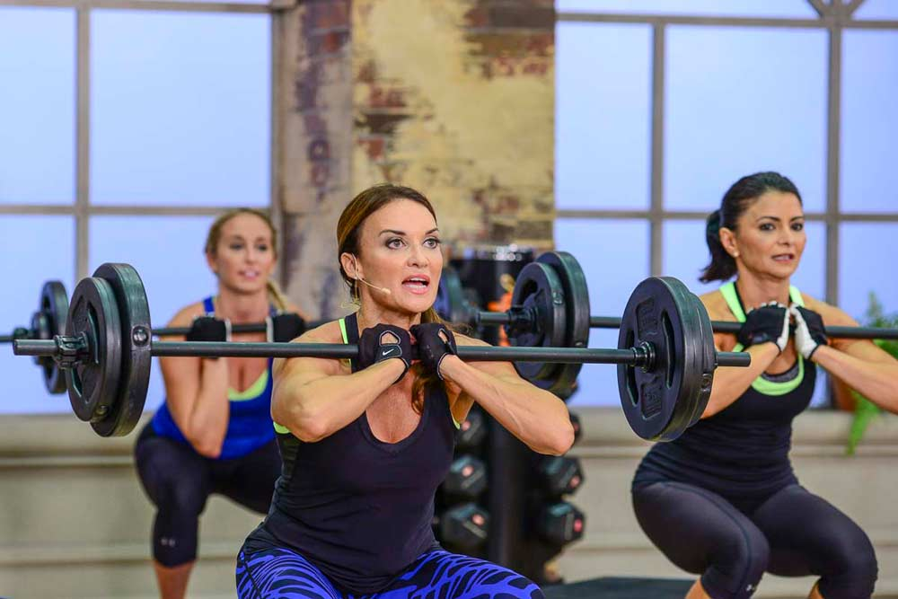image of cathe Friedrich,Nicole and Jai during Fit Split Push Day doing a front squat and toning muscles