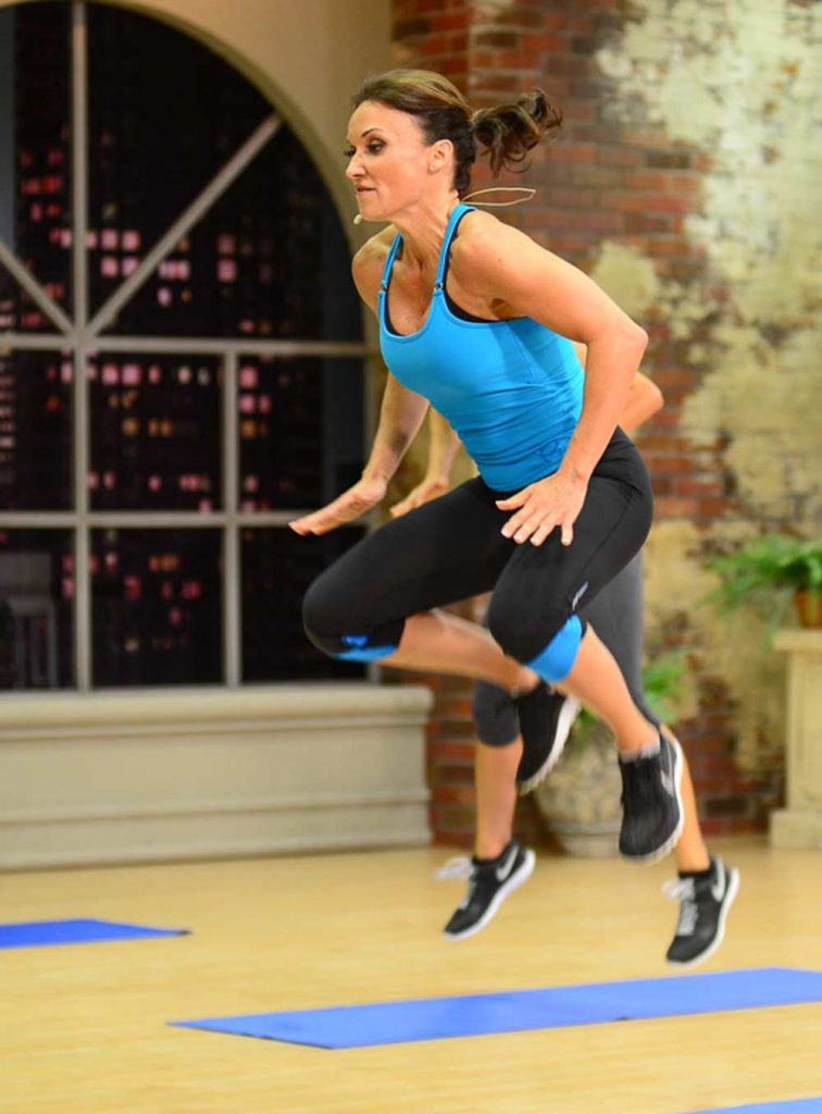 image of Cathe Friedrich jumping in Ripped With HiiT Plyo HiiT One