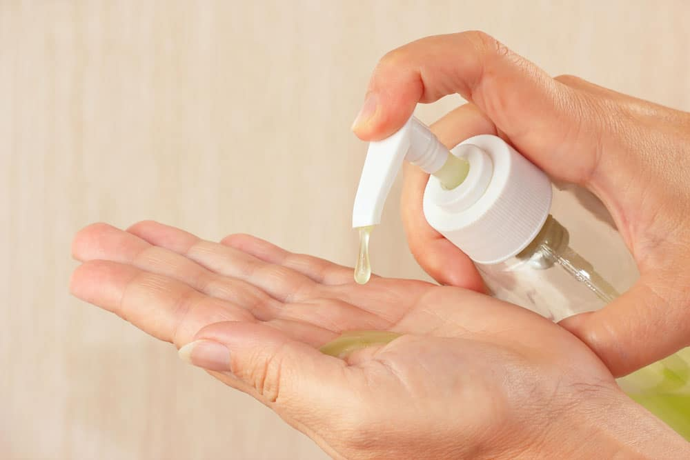 image of Female hands applying some different hand sanitizers
