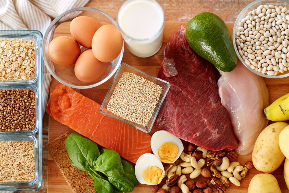 image of healthy eating and diet concept - natural rich in protein food on table