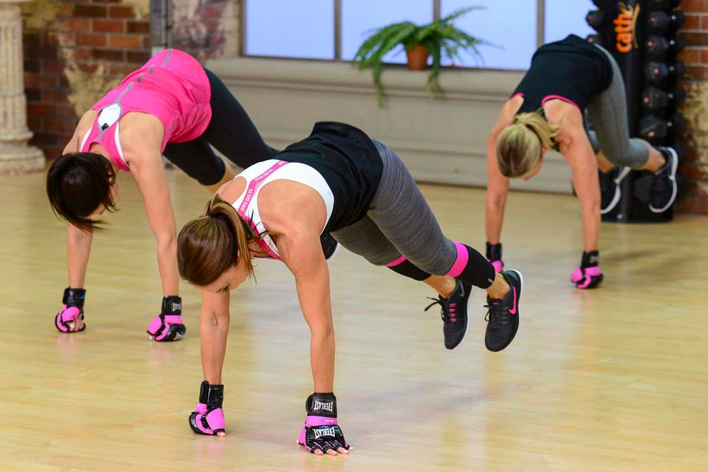 image of Cathe Friedrich doing a burpee in her Fit Split workout