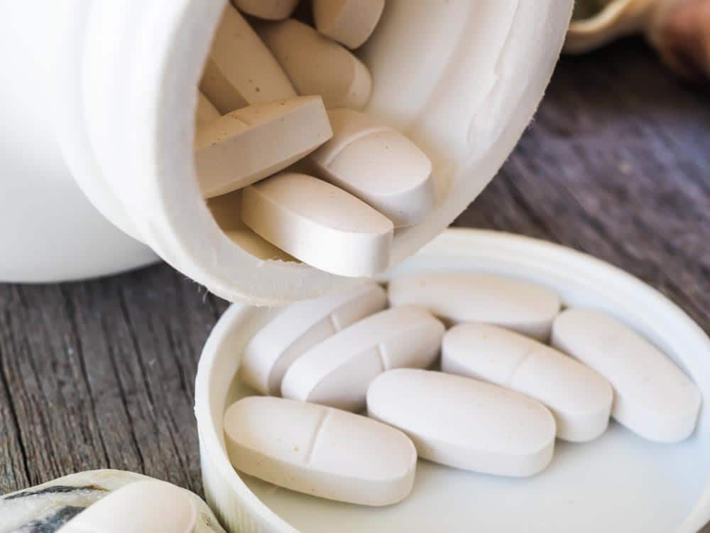 image of a opened bottle of calcium supplements