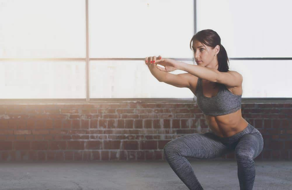 image of woman doing a squat without weights