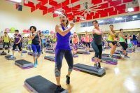 image of Cathe Friedrich motivating an exercise class at Four Seasons Fitness during the Glassboro Road Trip