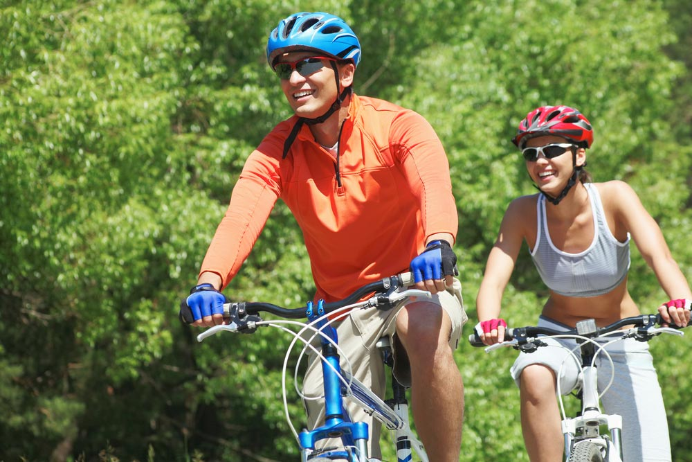 image of a man and a woman riding bicycles