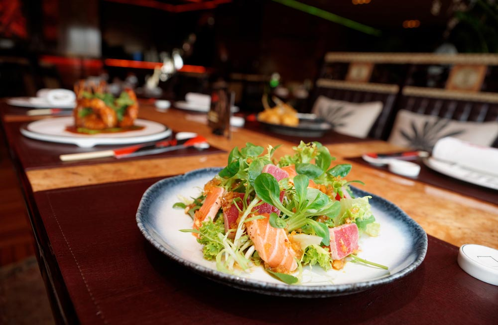 image of an appetizer with rare fried tuna and salmon on restaurant table