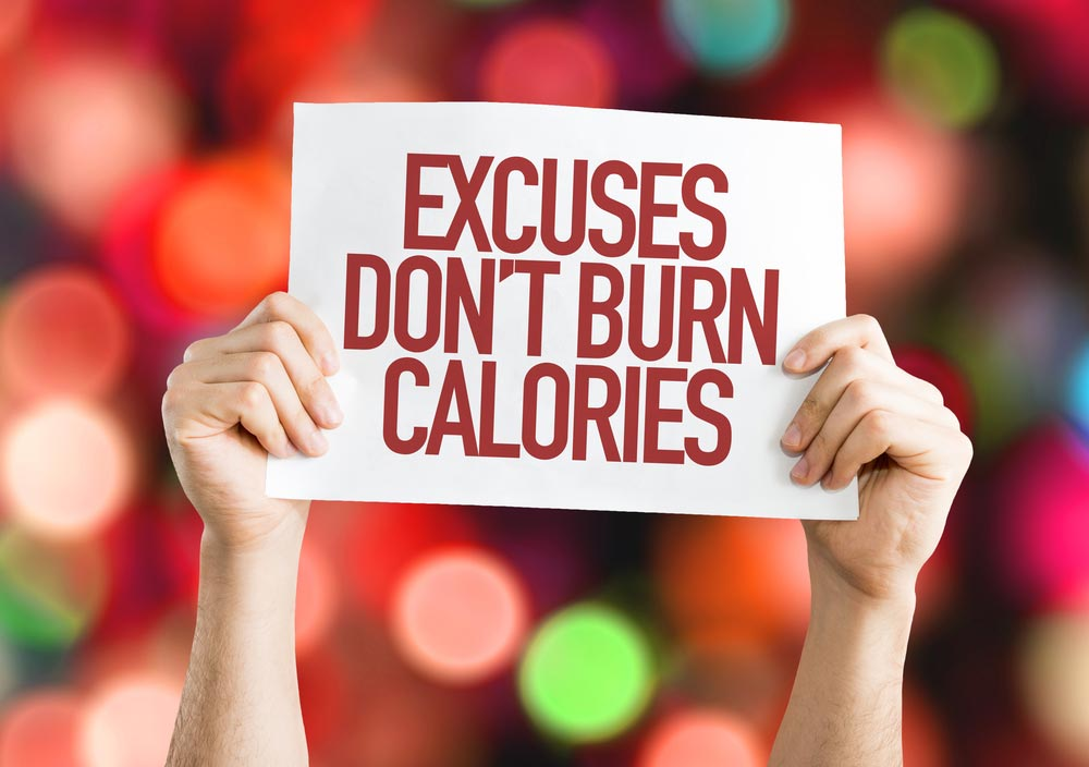 image of Excuses Don't Burn Calories placard with bokeh background
