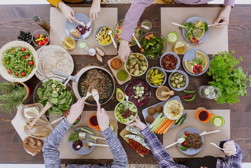 image of green healthy vegetarian food for lunch with friends