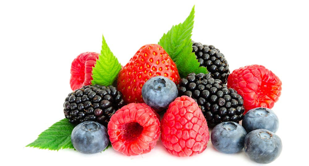 image of close-up arrangement mixed, assorted berries including blackberries, strawberry, blueberry, raspberries and fresh leaf isolated on white.