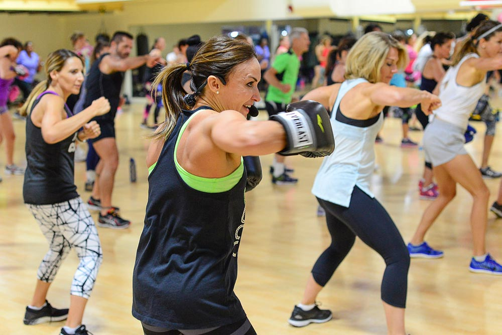 image of Cathe Friedrich leading a kickboxing class during the Glassboro road trip