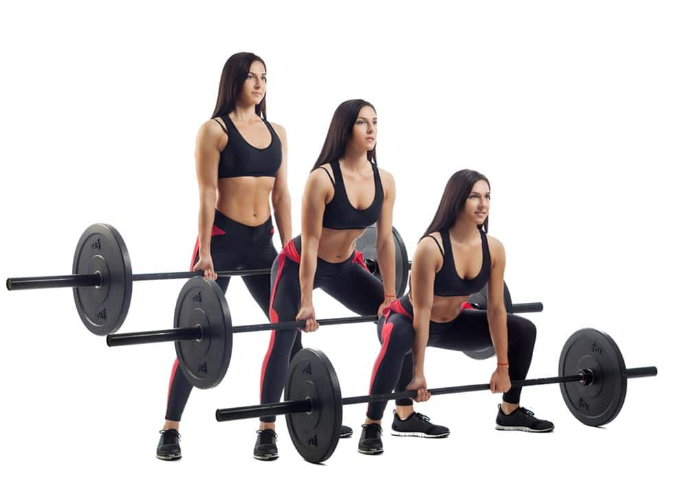 Young athletic brunette woman doing deadlifts with a barbell on white isolated background, front view, three positions