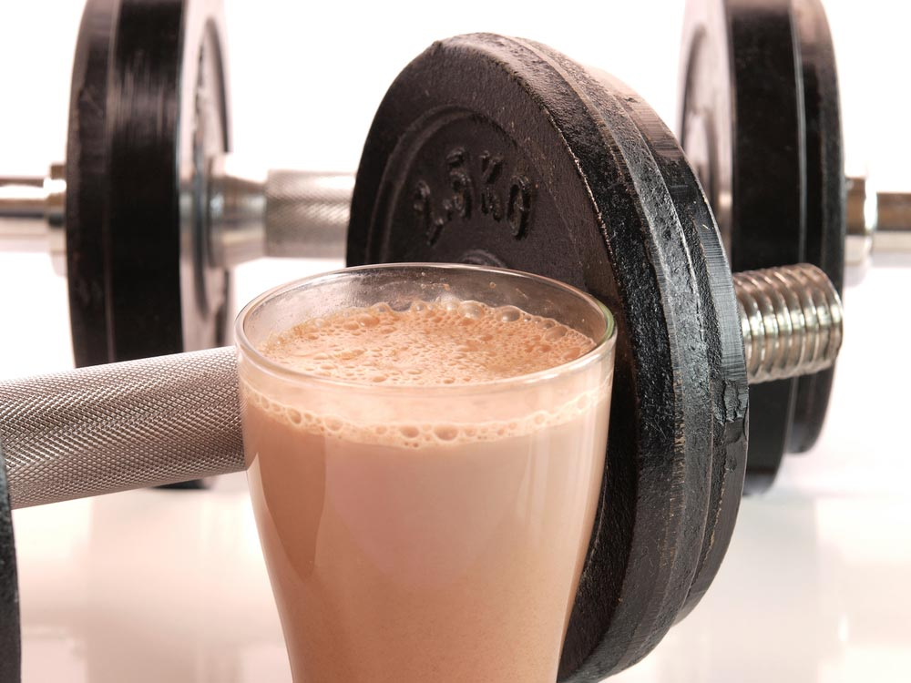 Fitness drink with heavy weights. Are you getting enough daily total protein