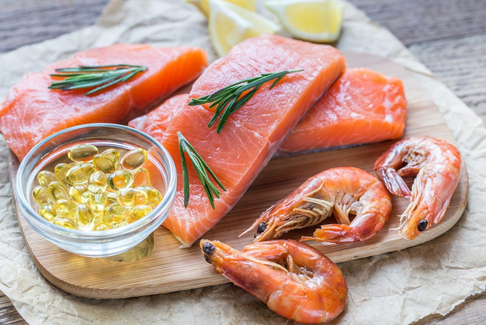 Sources of Omega-3 acid and fish oil (salmon, shrimps, Omega-3 pills)