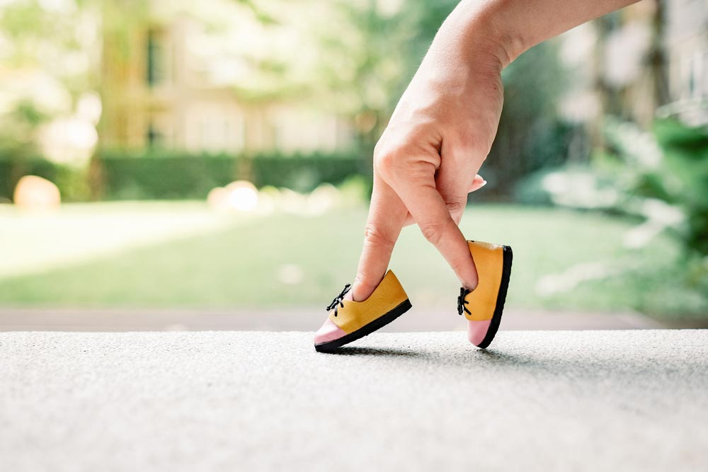 Woman hand finger walking with shoe concept. All women should be concerned about their risk of osteoporosis