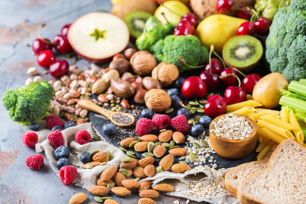 Selection of rich fiber sources vegan food. Vegetables fruit seeds beans and other excelelnt sources of viscous fiber an soluble and insoluble dietary fiber.