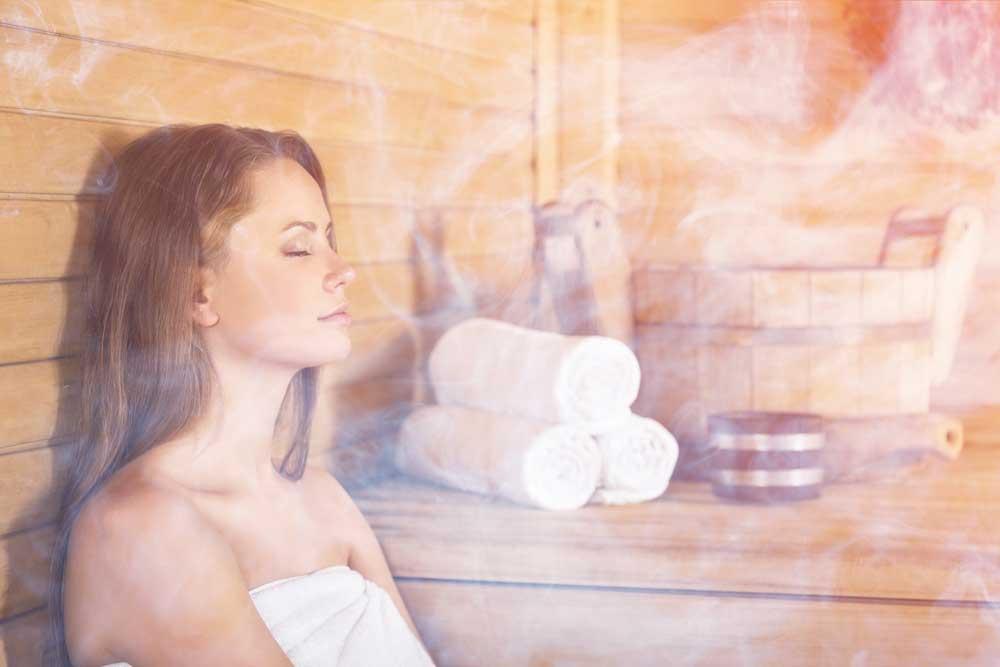 A woman sitting in a sauna