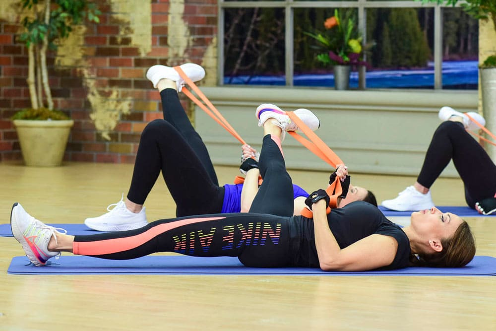 Cathe Friedrich stretching using her Boss Bands
