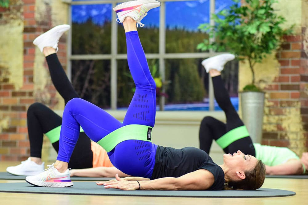 Cathe FRiedrich demonstrates an exercise using her Boss Loop that van help fix a glute Imbalance